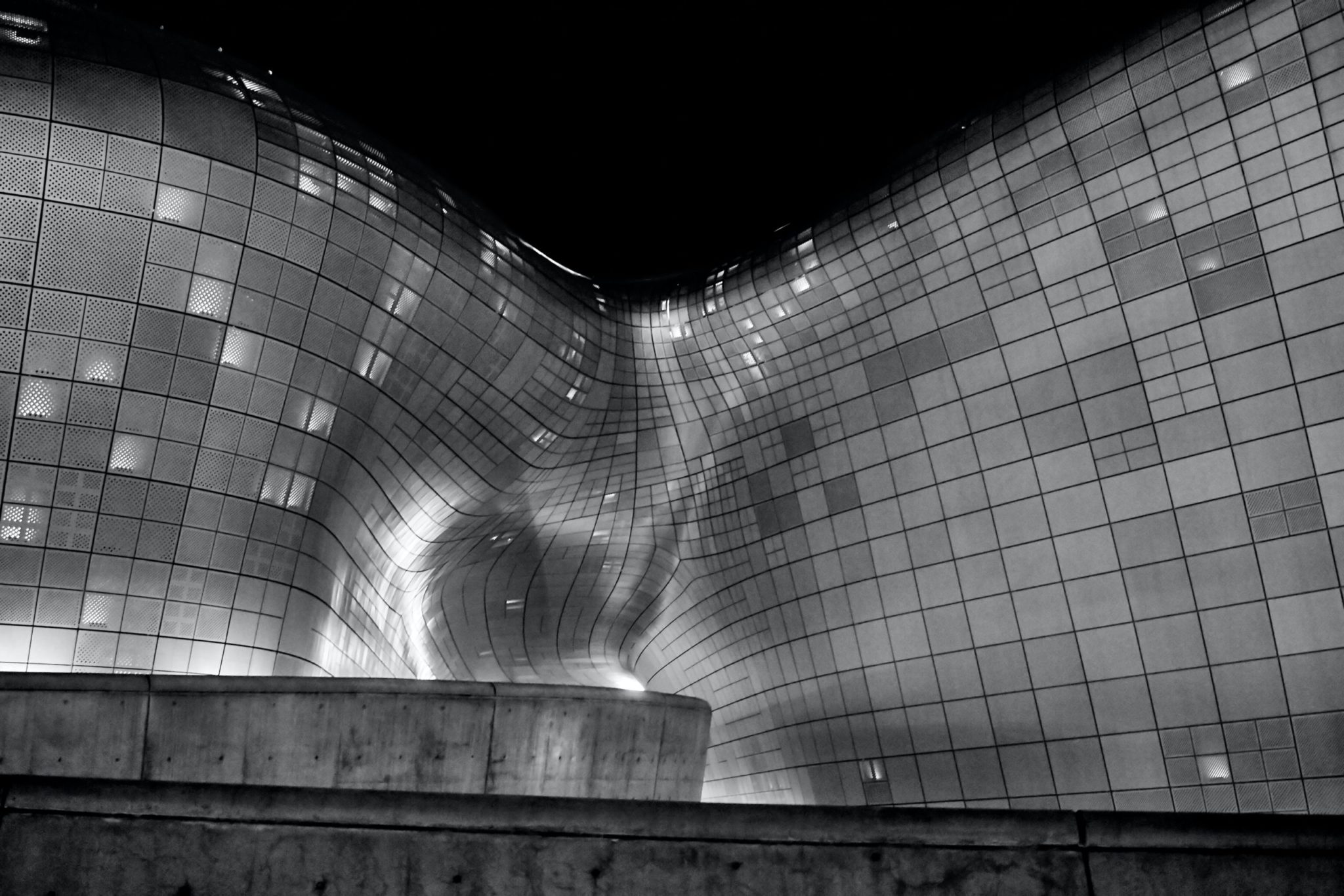 grayscale photography of glass building