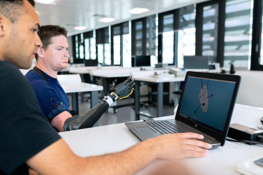 man in blue crew neck t-shirt using black laptop computer