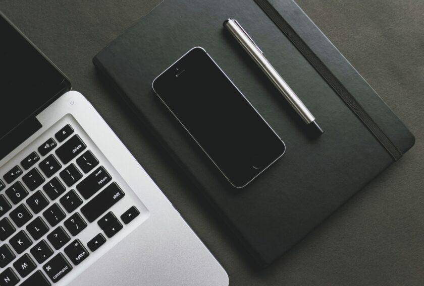 iPhone 5s near laptop